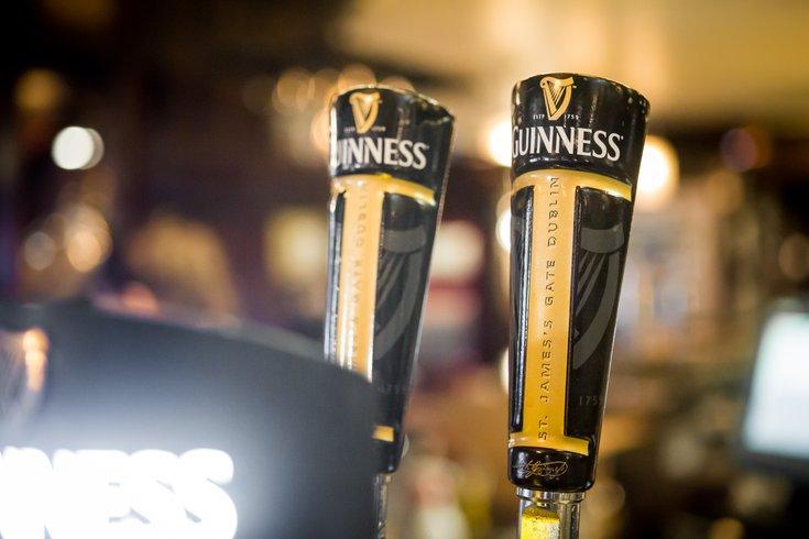 Stock_Carroll - Guinness beer taps at Fado Irish Pub