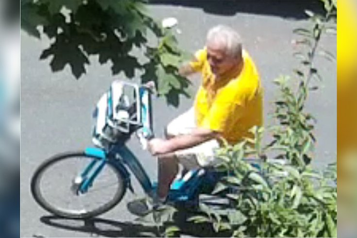 old man package thief on bike