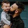 Man Holds Child 08032019