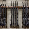 Stock_Carroll - Shotguns locked in a rack