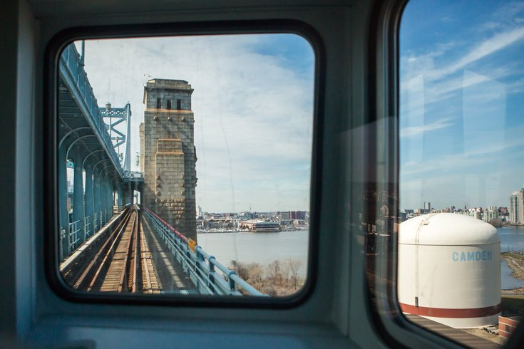 Stock_Carroll - Riding a PATCO train over the Benjamin Franklin Bridge