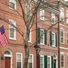 Carroll - An American flag hangs on a row house in Society Hill