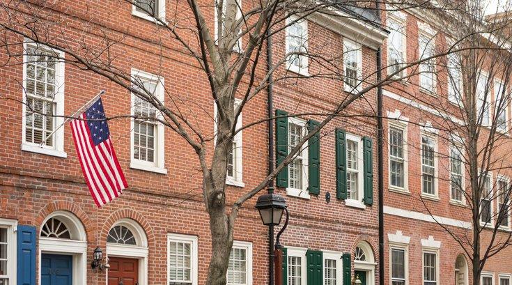 Carroll - An American flag hangs on a row house in Society Hill