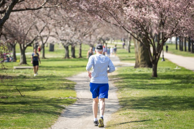 Person running along a trail in Philly