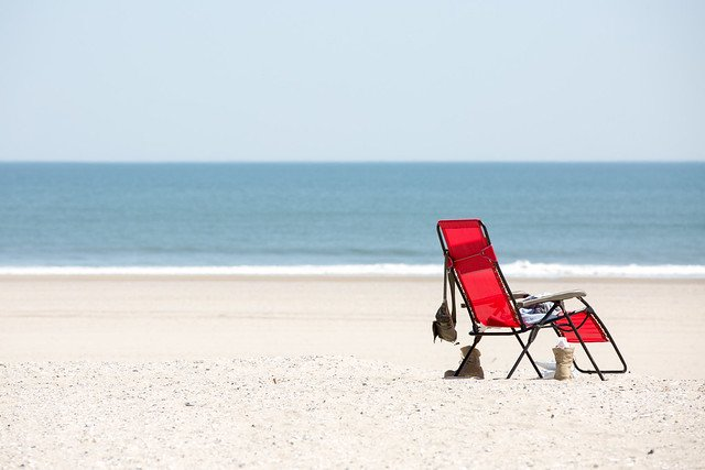 Beach chair along the shore