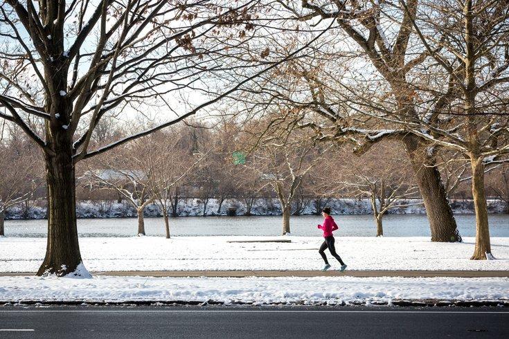 Woman running along river banks ibx rej