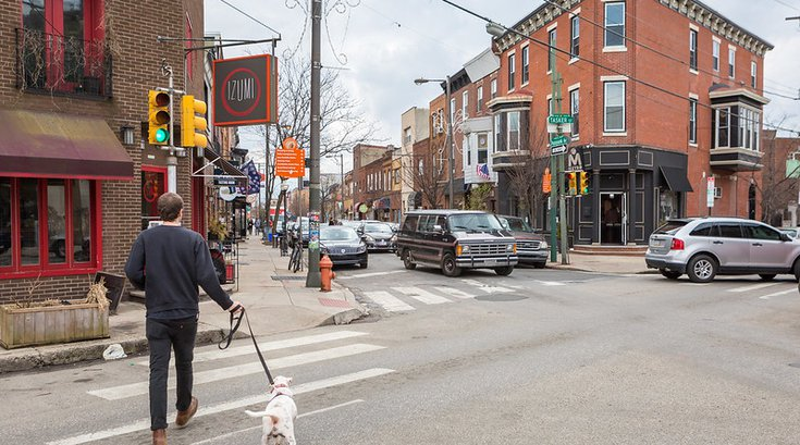 Man walking a dog in South Philly - Passyunk