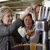 Hillary Clinton pours a beer