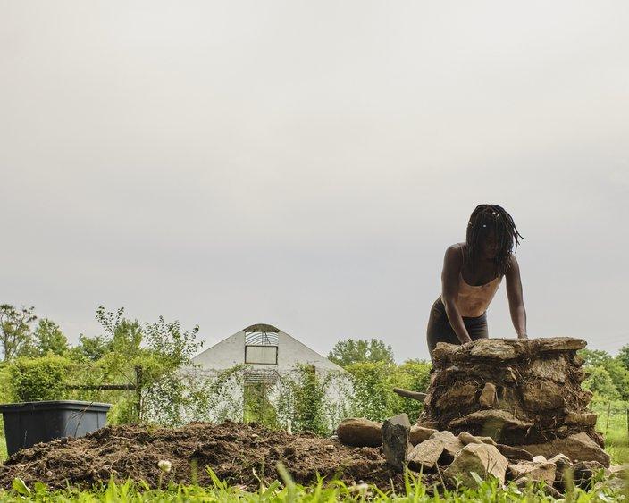 Artist Misty Sol builds furrows in Bartram Garden
