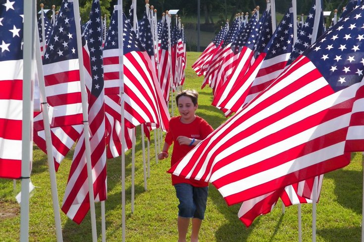 Limited - Child Running Through American Flags