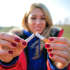Woman breaking cigarette in half quitting
