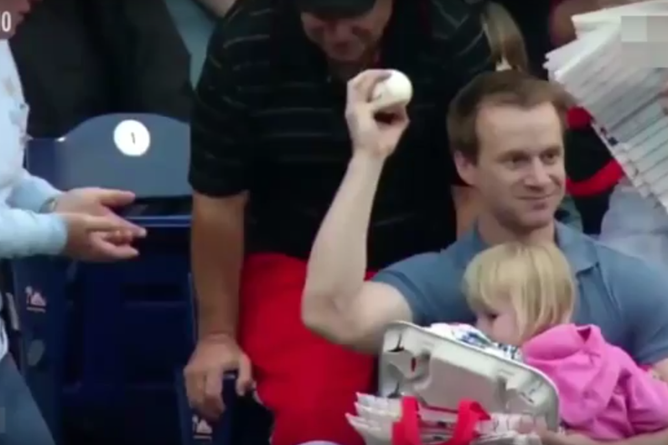 Dad catches ball.