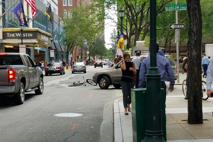 Bicyclist jumps on car