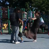 Woman kicking boy at Tacony Park