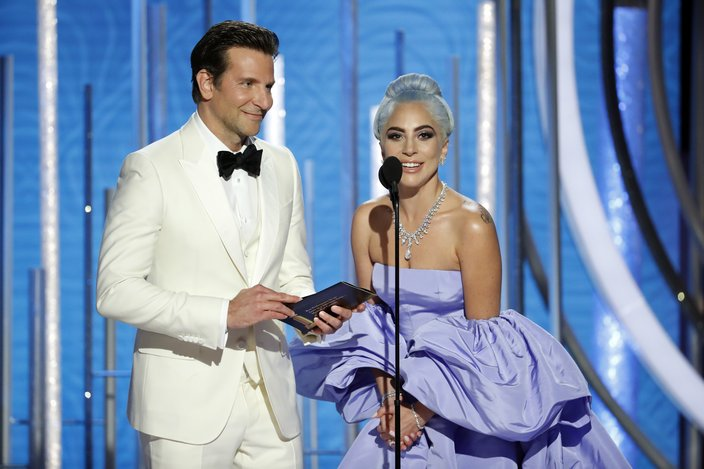 Lady Gaga and Bradley Cooper present at the Golden Globes
