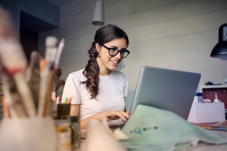 Woman working at desk being creative