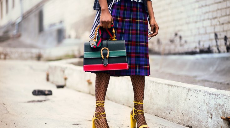 Fashionable woman standing outside