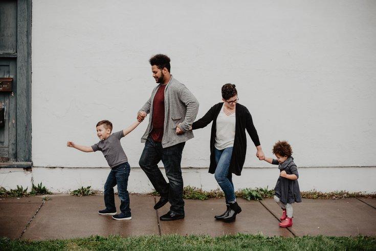 Family taking a leisurely walk outside