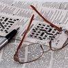 Glasses on newspaper crossword puzzle