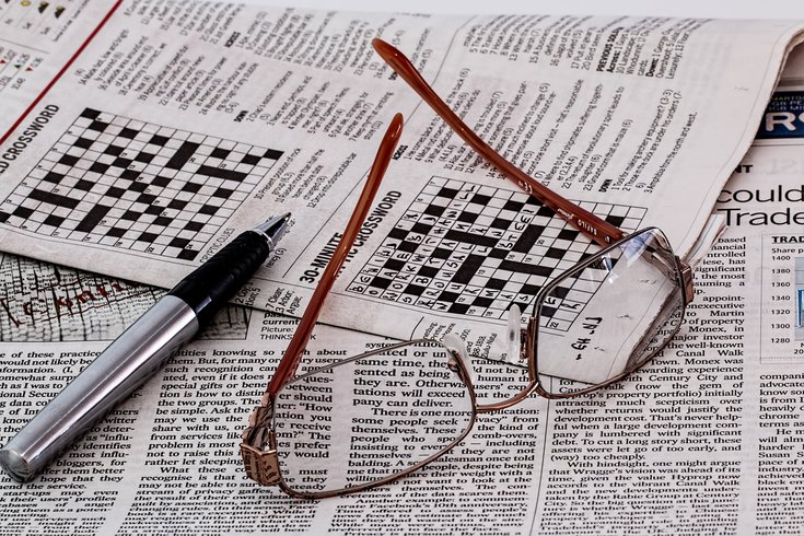 Glasses on newspaper crossword puzzle