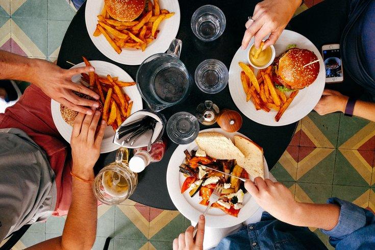friends eating together at restaurant