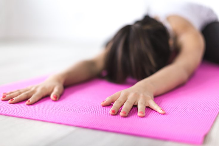 Woman meditating on a mat