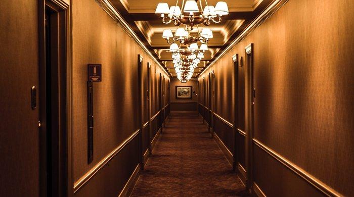 Hotel hallway dark and grim