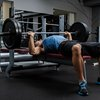 Man using a weight bench at gym