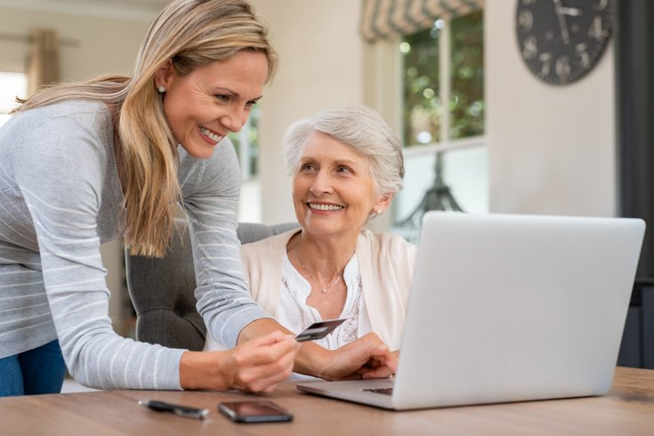 Mother and daughter doing shopping online