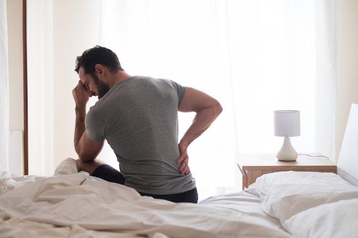 Limited - Man feeling backache after sleeping in bed