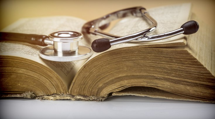 Stethoscope on an old book of medicine