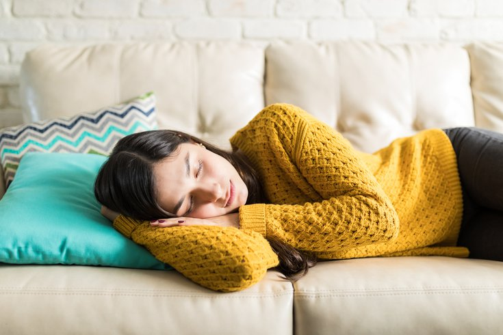 Woman taking a nap on the couch