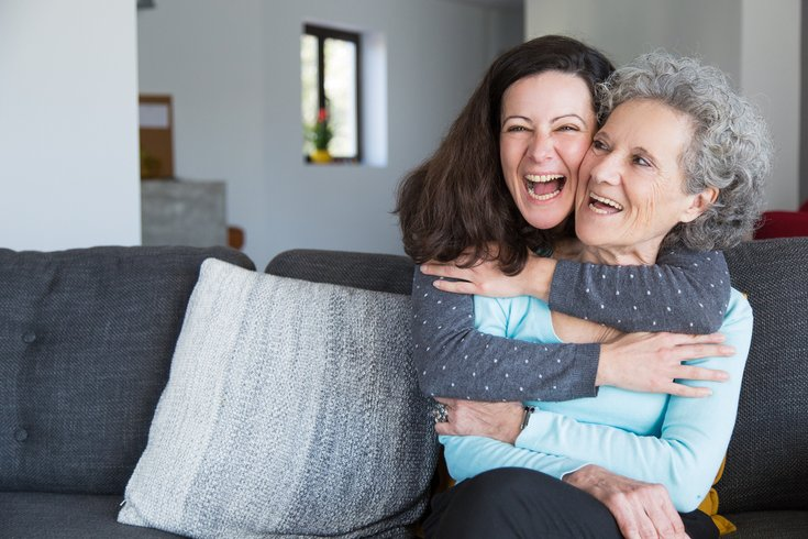Elderly woman smiling with a friend