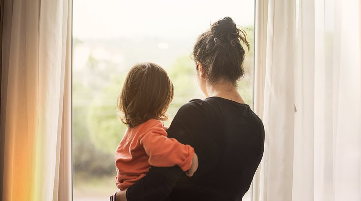 Purchased - Mother and son looking out window