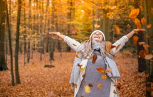 Happy Woman in Autumn leaves