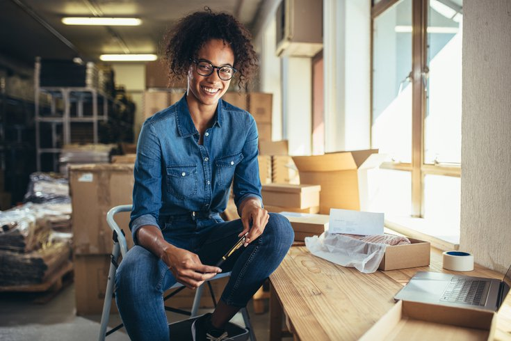 Limited - Woman sitting in commercial workspace