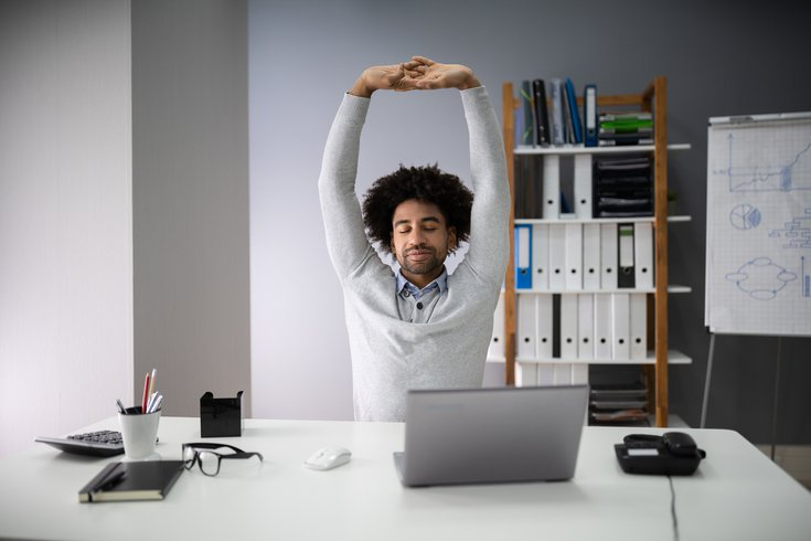 Businessman Stretching His Arms stock photo