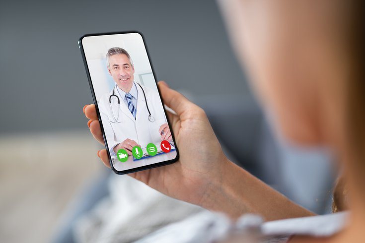 Person video chatting with doctor