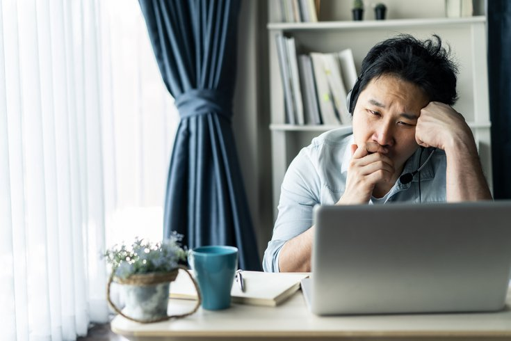 Purchased - man feeling tired, bored and sleepy while working