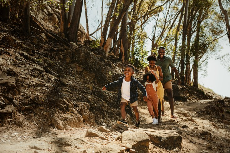 Purchased - Family running down rocky trail