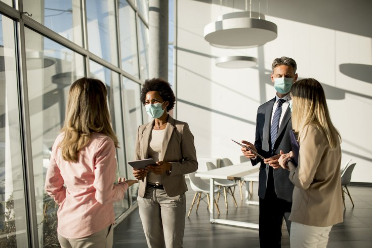 Purchased - People working in an office with masks