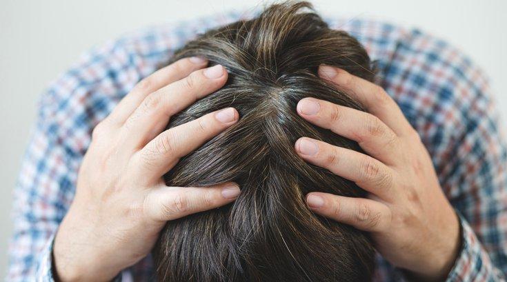 Purchased - Man with headache or brain fog