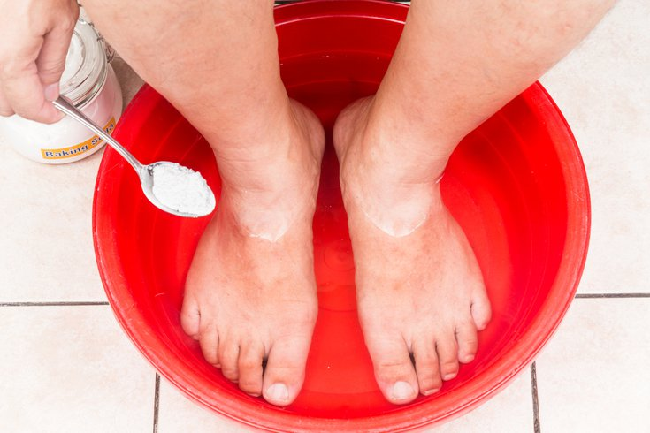 Purchased - Pouring baking soda in water to treat feet