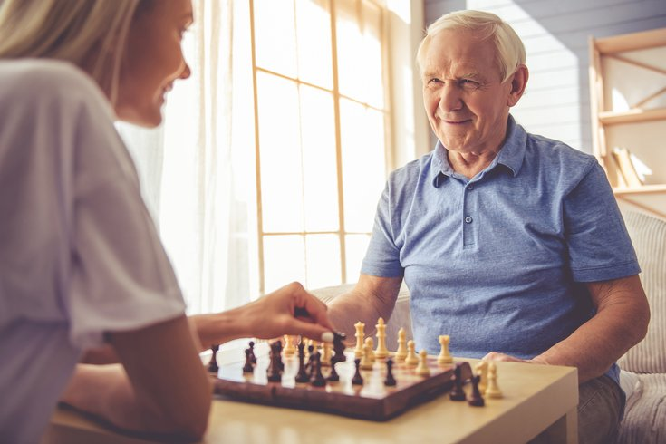 Purchased - Playing chess with senior citizen