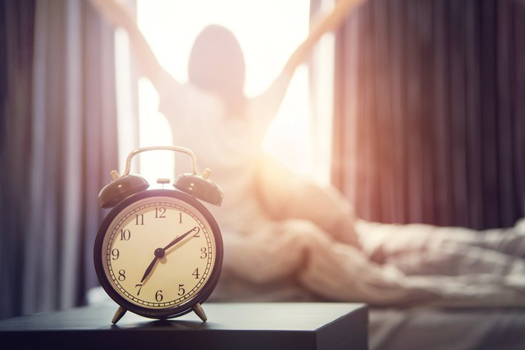 Alarm clock on nightstand on morning