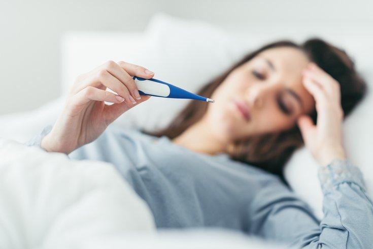 Woman measuring her temperature