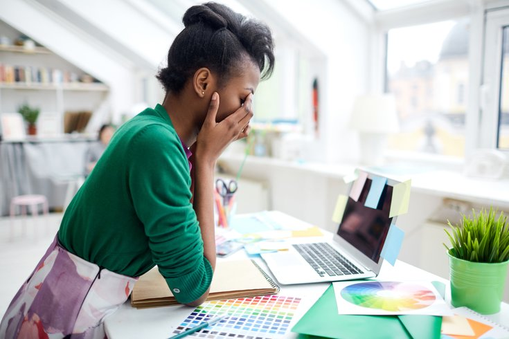 Fashion designer stressed at work