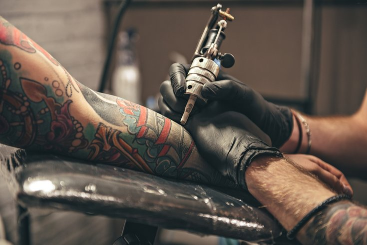 Limited - Male tattooing  image on arm
