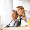 Woman with nurse in assisted living
