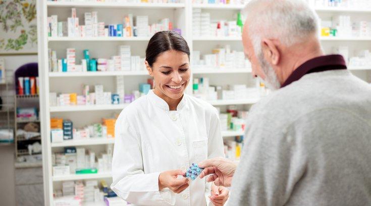 Pharmacist speaking to customer